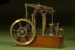 """model of a four column rotative James Watt vertical steam engine of the reciprocating beam type with double-action low-pressure single-cylinder, Watt's """"parallel motion"""" linkage, and Watt's centrifugal speed governor"""